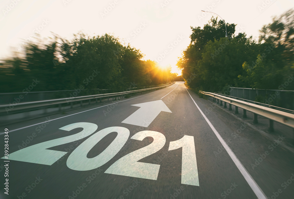 Fototapeta Empty road in the forest to upcoming 2021
