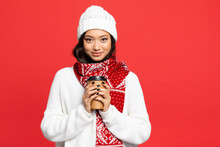 Happy Asian Woman In Hat And Scarf Holding Disposable Cup With Coffee To Go Isolated On Red