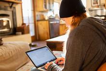 Teenage Girl Using Her Laptop ...