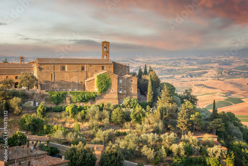 Fototapeta premium View of Montalcino, countryside landscape in the background, Tuscany, Italy