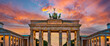 canvas print picture - Panorama of the Brandenburg gate illuminated at sunset in Berlin, Germany