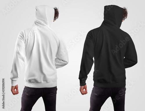 Obraz Template of fashionable casual hoodie on a guy in a hood, back view, white and black sweatshirt, for presentation of design, pattern, print. - fototapety do salonu