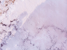 Amazing Forms Of Land Surface Made Of Water And Salt, Nature Abstract Background, Aerial View. Pink Extremely Salty Kuyalnik Liman In Odessa, Salty Layer On The Bottom Of Shallow Lake