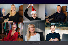 Virtual Christmas Meeting Team Teleworking. Family Video Call Remote Conference Computer Webcam Screen View. Diverse Portrait Headshots Meet Working From Their Home Offices. Happy Hour Party Online