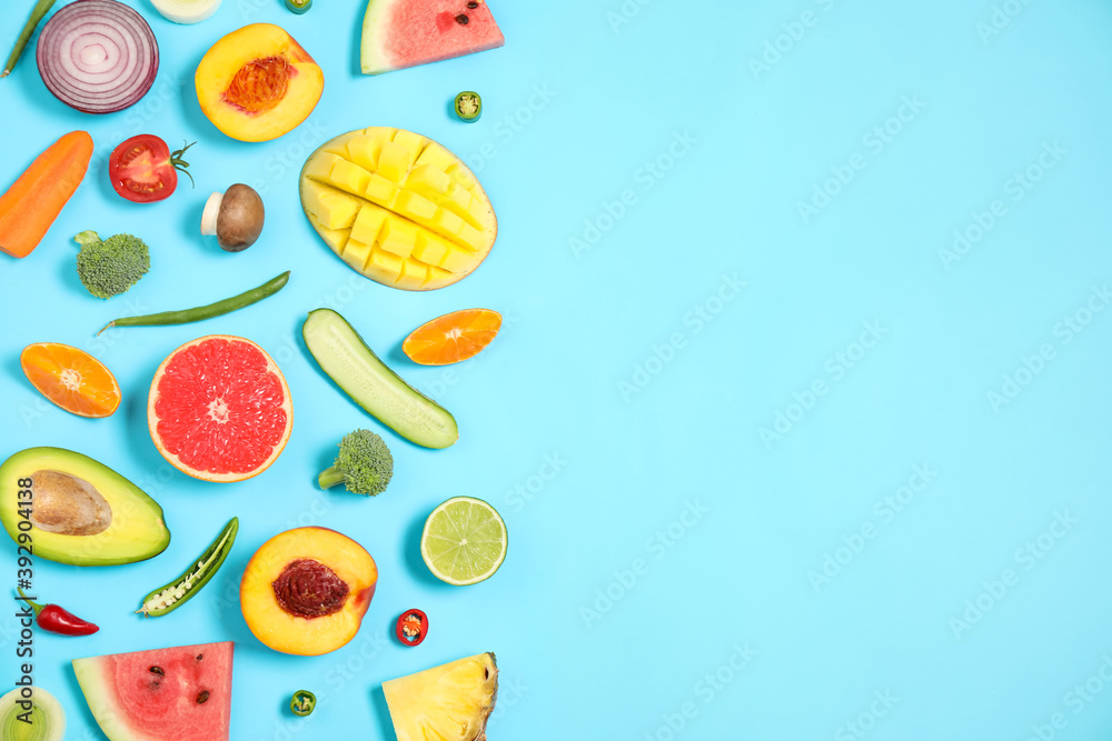 Fototapeta Flat lay composition with fresh organic fruits and vegetables on light blue background. Space for text