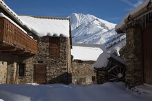 Winter Scene Of A Quiet Village In The French Alps With Majestic Mountain Peak In The Distance