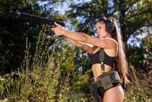Young Sexy Slender Caucasian Woman Soldier Shooting With Rifle Machine Gun In The Wild Forest, Female Army Nature Outdoor Military Combat Training.femme Fatale