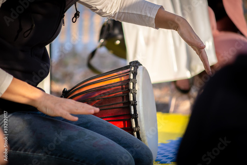 The girl plays the Djembe drum for children Fotobehang