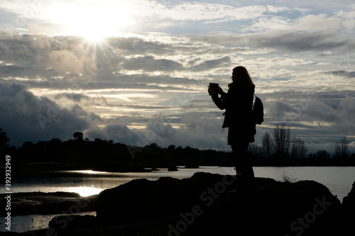 Cuadros en Lienzo Woman taking photos in Los Barruecos, granite formations and ponds with great an