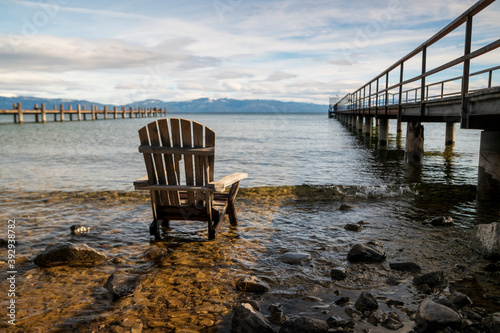 Abandoned deck chair by Lake Tahoe pier Fototapet