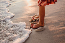 Burying Her Toes In The Sand On The Beach At Pensacola, Florida