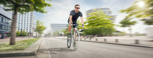 Athletic Cyclist Riding In The City