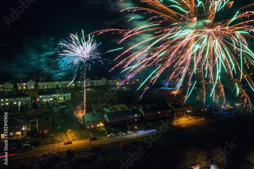 Fototapeta Aerial view of fireworks over south wales houses on bonfire night, United Kingdo