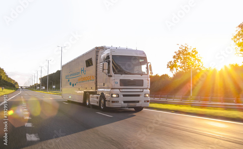 hydrogen fueled truck on the road driving. h2 combustion Truck engine for emission free ecofriendly transport.