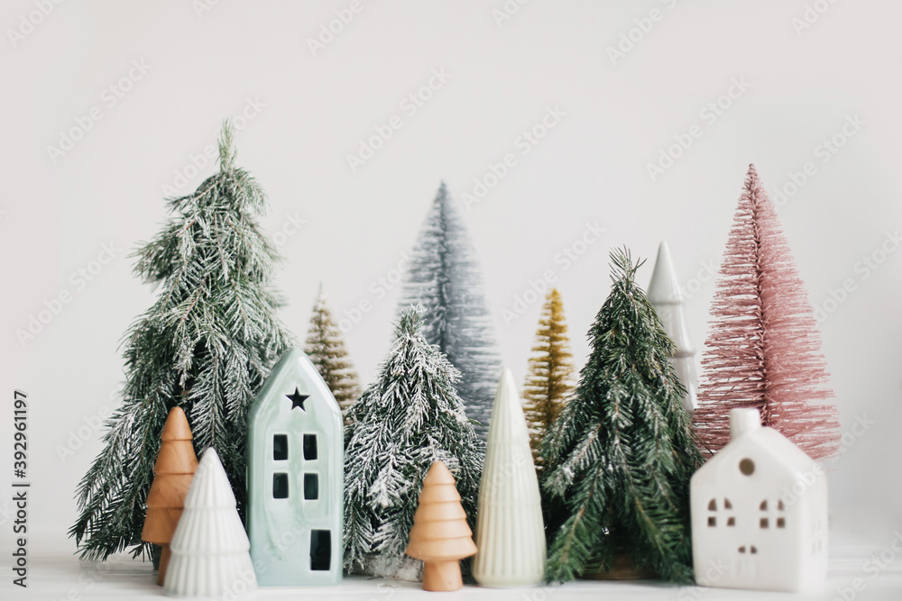 Fototapeta Merry Christmas! Christmas scene, miniature holiday village. Christmas little houses and trees