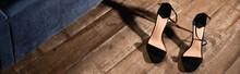 Black High Heeled Shoes On Woo...