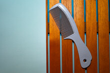 Blue Hair Comb On A Blue And W...