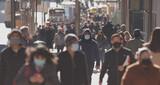 Fototapeta Nowy Jork - Crowd of people walking street wearing masks