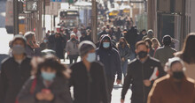 Crowd Of People Walking Street Wearing Masks