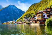 Scenic Panoramic View Of Famous Hallstatt Lakeside Town Reflecting In Hallstättersee Lake In The Austrian Alps In Scenic Light On A Beautiful Sunny Day In Autumn, Salzkammergut Region, Austria