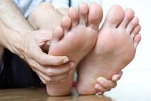 Foot Pain Leg Of Woman Sitting...
