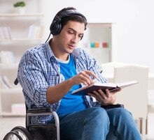 Disabled Man Listening To Musi...