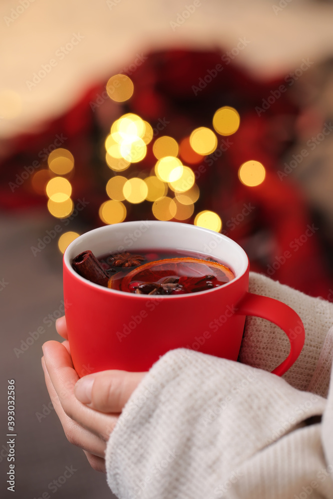 Fototapeta Woman drinking tasty mulled wine at home on Christmas eve