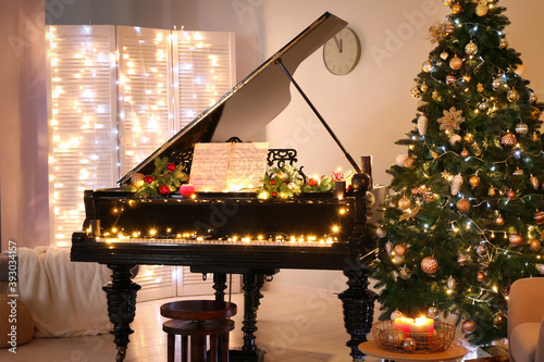 Interior of room with grand piano decorated for Christmas