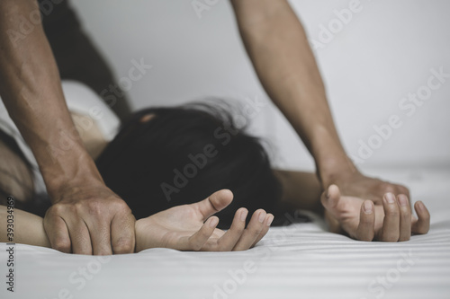 Fotomural Close up  man hands holding a woman hands for rape and sexual abuse concept