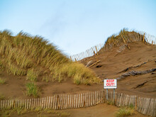 Old Wooden Fence And Sign Keep Out Dune Restoration Works. Blue Clear Sky, Nobody, Concept Ecology And Environment Protection