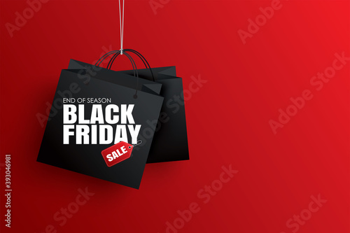 Black friday sale with black shopping bag and the rope hanging on red background