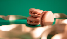 Pink Macarons On A Green Background.
