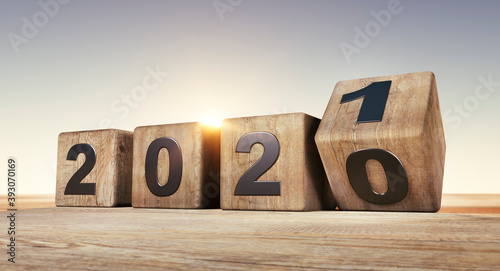 Fototapeta New year 2020 change to 2021 concept - changing wooden cubes obraz