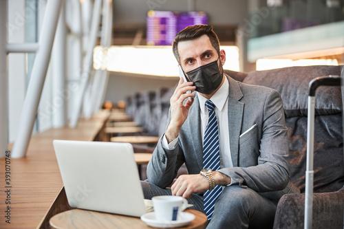 Fotomural Entrepreneur listening to his phone conversation partner