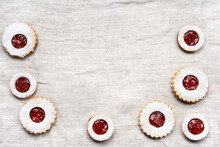 Christmas Linzer Cookies On Light Wrinkled Tablecloth