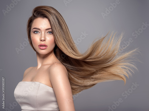 Beautiful woman with long straight hair. Blonde girl.