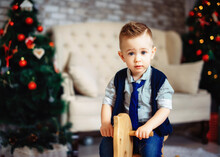 Lovely Baby On The Background Of Christmas Decorations. Close-up Portrait