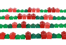 Real Estate Replica Houses In Lines Isolated On A White Background