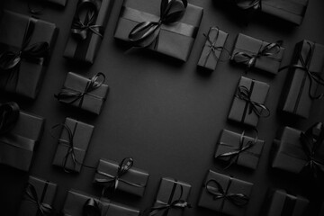 Panel Szklany Tenis Arranged Gifts boxes wrapped in black paper with black ribbon on black background. Christmas concept
