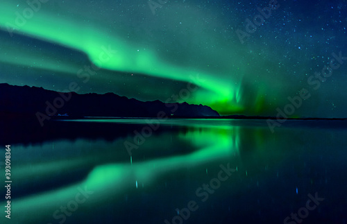 Aurora borealis over the lake. Northern light reflection. Fototapet
