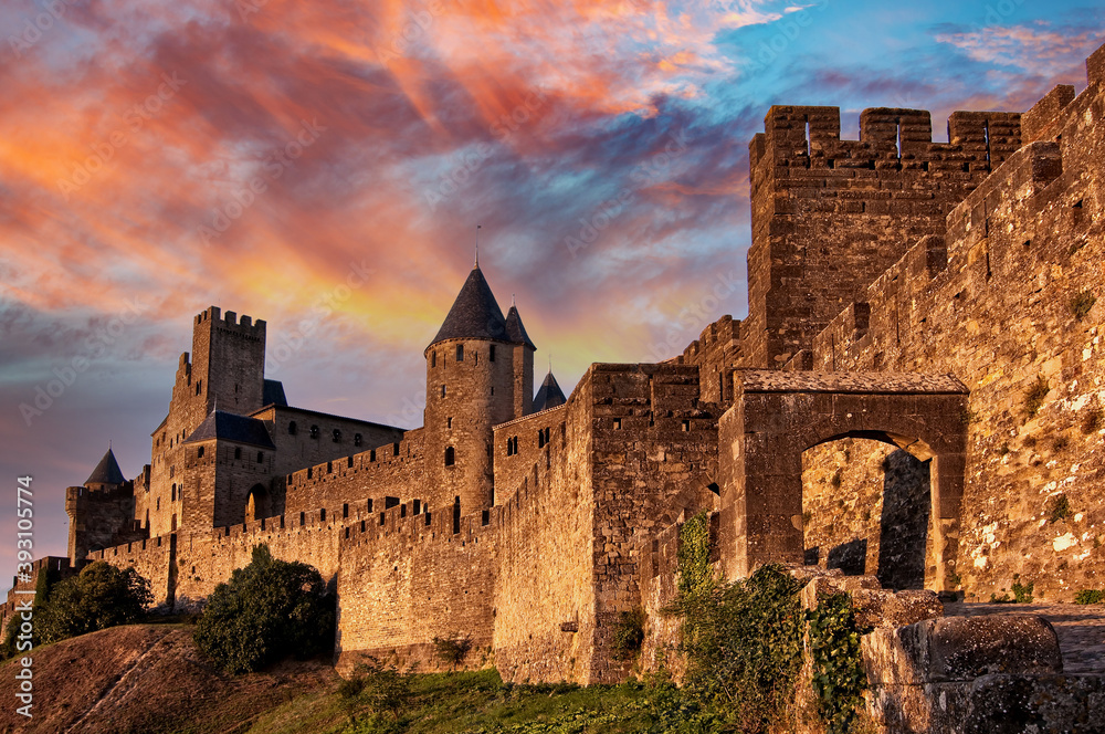 Fototapeta Medieval fortress of Carcassonne at sunset, France