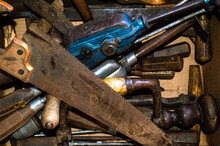 Old Rusty Tools Are Piled On A...