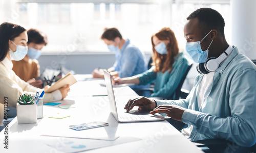Slika na platnu International people wearing medical masks using laptop