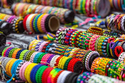 Fotografia Colour bracelets for hands on the market