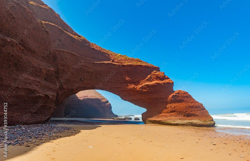 Fototapeta Red arches of Legzira beach, Morocco.