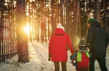Family Walking In Wintertime