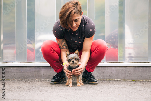 Obraz Woman trying to educate her yorkshire terrier dog - fototapety do salonu