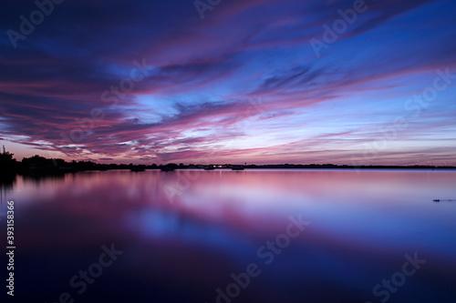 clouds reflecting off a lake at dusk Canvas Print