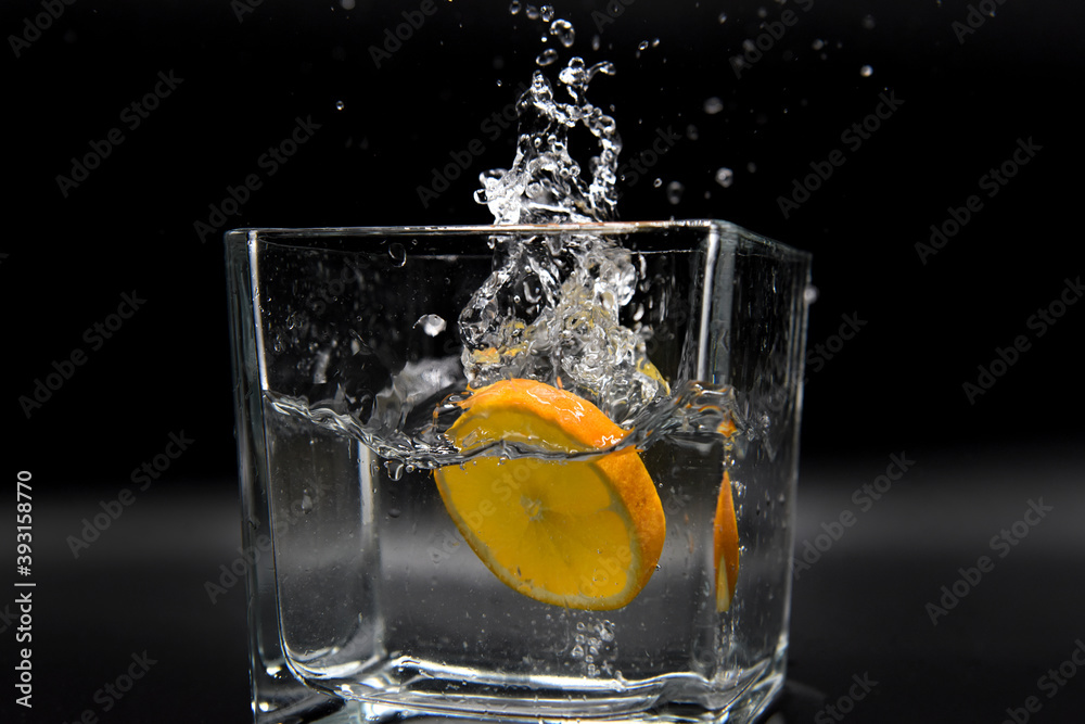 Fototapeta arance acqua fetta schizzo spruzzo
