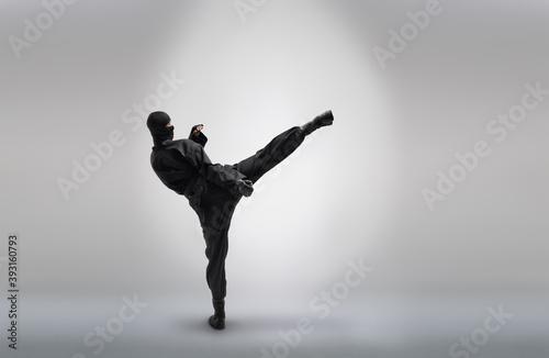 Stampa su Tela japanese ninja in black uniform, on grey background